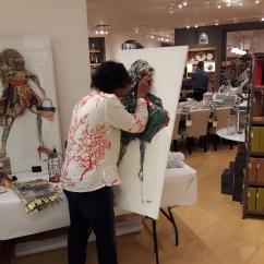 AponteSierra working on his paper manipulation Fine Art Technique during his meet the Artist event at Williams Sonoma, Palm Beach Gardens, Florida.