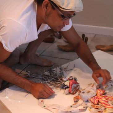 AponteSierra Working his paper Manipulation Fine Art Technique